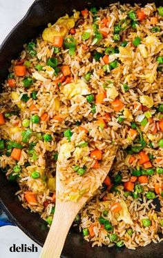 Perfect Fried Rice is part of Homemade fried rice - Fried Rice from Delish com is the best thing to make with your leftover rice Homemade Fried Rice, Making Fried Rice, Homemade Recipe, Easy Fried Rice, Healthy Fried Rice, Quinoa Fried Rice, Fried Rice With Egg, Dishes With Rice, Cabbage Fried Rice