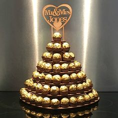 7 Tier Heart Shape Personalised Mr & Mrs Ferrero Rocher Pyramid, MDF Wedding Display Stand - Decoration For Home Ferrero Rocher Pyramid, Chocolates Ferrero Rocher, Ferrero Rocher Bouquet, Ferrero Chocolate, Money Bouquet, Chocolate Photos, Golden Wedding Anniversary, Candy Cakes, Tiered Stand