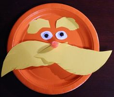 The Lorax paper plate craft using anorange paper plate, yellow and white card stock and wiggly eyes.