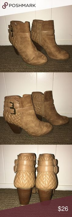 Brown Booties Brown gorgeous booties with sued. Has a zig zag pattern around the back. These shoes would be a cute accent piece to an outfit. Used once and were too small for me. Francesca's Collections Shoes Ankle Boots & Booties