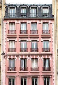 A beautiful pink building in Paris.