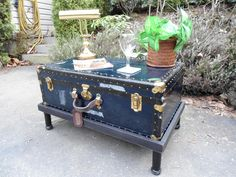 Add a wooden base and legs to raise the trunk to a coffee table height.