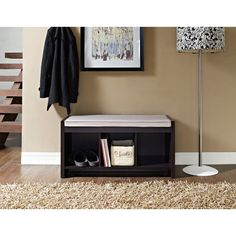 Add seating and function to any room with this storage bench with cushion. With three cubbies for storage, this bench provides extra seating or a place to put on your shoes. The cushion top ensures comfort no matter how long you're sitting.