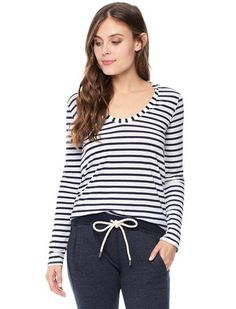 "Splendid x Damsel  Collaboration piece 	Soft and luxurious U-neck Top 	Classic Breton stripes 	Never goes out of style 	Relaxed fit 	U neckline 	Long sleeves 	Model is wearing size XS. She is 5'9"", 34-23-34, dress 2"