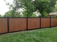 Amazing two-tone black and rosewood PVC Illusions Vinyl Fence installed by King Fence of Westchester, NY. Black and Rosewood Grand Illusions.