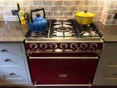St.Albans In-Frame Shaker finished in Dakar with an Amazing Burgundy Falcon 900mm Single Range Oven and grey crackle glazed metro tiles