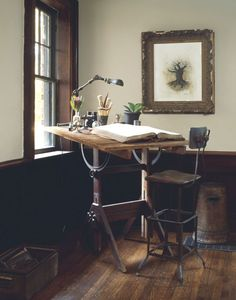 Loving the old drawing board table, and the idea of just needing this small area for working.