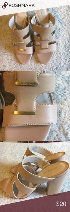 CALVIN KLEIN BEIGE HEELS NEW SIZE 8 WORN ONCE CALVIN KLEIN SLIP ON BEIGE HEELS. CLASSIC STYLE WITH GOLD METAL ACCENTS. WORN ONCE. NO SCRATCHES. WOMEN'S SIZE 8. EURO 38. COMFORTABLE! Calvin Klein Shoes Heels