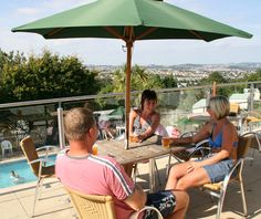Cool down with a refreshing drink on the terrace overlooking the outdoor pool at Beverley Bay, South Devon