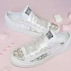 I like how they bedazzled these converse, and I was thinking we could put the wedding date on one side and I do on the other side.