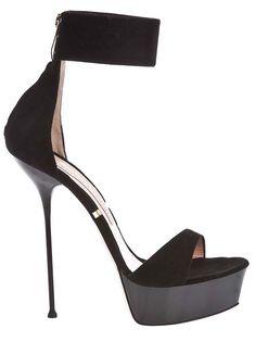 That heel. I'm up for the challenge of staying vertical.  Gianmarco Lorenzi Black Platform Stiletto High Heel Sandal