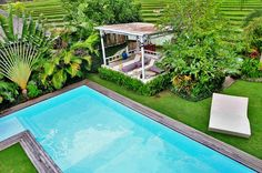 As you walk in the gate of the property, you are welcomed by lush landscaped garden #bali #villa #rental #ricefields #view #house #luxury #nature