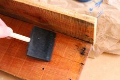 Applying Danish oil to DIY baseball hat rack Diy Planter Box, Diy Planters, Baseball Hat Racks, Diy Sponges, Diy Plate Rack, Diy Concrete Countertops, Diy Hat, Dollar Tree Store, Wood Pallets