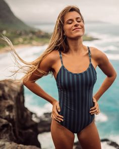 NEW SWIMSUITS! Our Classic One-Piece is NOW available in our Deep Seas vertical striped print! It's slimming, modest, chic and features an open back style. Show off that summer tan in this beautiful, trendy swimmer! To see more from the High Seas Collection, head to albionfit.com #swimsuit #swimwear #swim #shopswimsuits #swimmer #swimmie #slimmingswimsuits