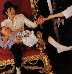 Michael Jackson~A nurse handing him a pacifier~ He so loved to take care of his children!