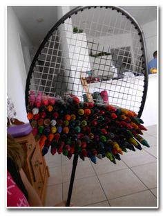 A Badminton Racket Stuffed With 100 Crayons   ...painful and yet very colorful!