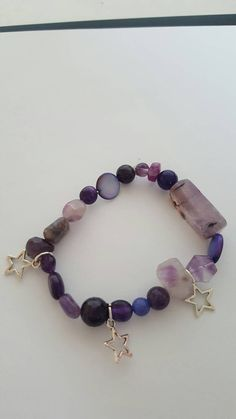 Check out this item in my Etsy shop https://www.etsy.com/uk/listing/285629837/purple-multi-gemstone-stretchy-bracelet