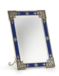 A Large Silver-Gilt and Guilloché Enamel Photograph Frame by Fabergé, workmaster's mark of Victor Aarne, St. Petersburg, 1896-1904. Rectangular with outset corners, enameled in translucent royal blue over a wavy guilloché ground within a beaded border, applied with cast and chased openwork foliate motifs in the Old Russian style, with stepped bezel now enclosing a mirror.