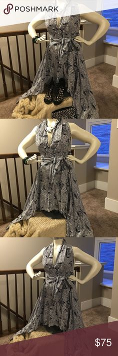 Beautiful African Print halter wrap dress! This is a gorgeous African Print halter wrap dress! The black and white bird print is absolutely stunning! I could not take a photo to show the true beauty of this piece. The side of the dress are long then the front and back. Depend on your body shape you may need to pin the back or wear a body con skirt with this dress. A tank or camisole may also be need as it is a halter and the back is completely open, and the chest has a deep v. I believe this…