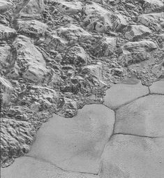 In this highest-resolution image from NASA's New Horizons spacecraft, great blocks of Pluto's water-ice crust appear jammed together in the informally named al-Idrisi mountains.