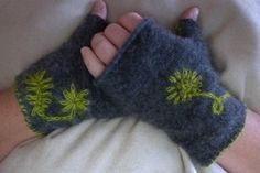 The best part about knowing how to knit/crochet and felt means I can find things like this onling and I dont have to blow the money when I can just make it myself.   fingerless mittens by emperorming1 on Etsy, $24.00