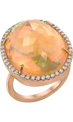 I can get a blood red Mexican opal roughly this size for 825 USD. Small diamonds like this are roughly 1800/ct total carat weight. Doubt that's an oz of gold which is roughly 1700+/ounce. This ring is going for 24,160 USD. Yeah, right. *cough*rip-off*cough