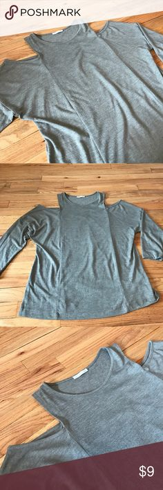Zara cold shoulder top. Loose fit cold shoulder look. Pre loved and still has a long way to go. Zara Tops