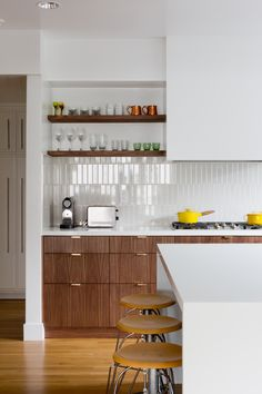 walnut veneer cabinets and brass cabinet pulls. Los Angeles Kitchen Remodel by Veneer Designs | Remodelista