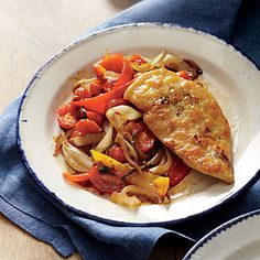 Thin chicken cutlets cook in butter for a rich, savory flavor, while bell peppers stew in fruity olive oil.