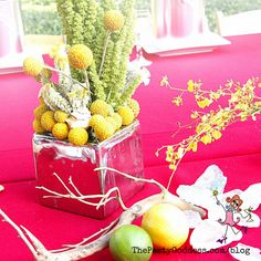 Pair Billy Balls (those yellow flowers that look like lollipops) with some ferns driftwood and citrus and you've got yourself a statement-making arrangement! Billy Balls, Christmas Snow Globes, Indoor String Lights, Handmade Christmas Decorations, Works With Alexa, Light Bulb Types, Colorful Furniture, Spring Day, Yellow Flowers
