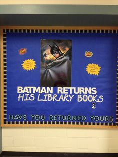 Batman returns his library books. Getting ready for end of school year.