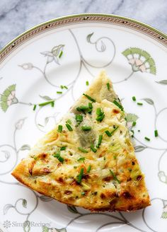 Artichoke Leek Frittata ~ Tender frittata with eggs, sautéed leeks, artichoke hearts, Parmesan, tarragon and chives. Perfect for Spring! ~ SimplyRecipes.com