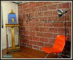 Amazing! Cinder block painted to look like antique brick with vintage advertising sign