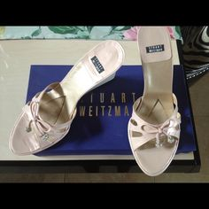 Stuart Weitzman wedges Stuart Weitzman Pink wedges with bow ties and crystal ball jangles. Pink is light with a metallic touch. Wedge is like lucite, very pretty and in very good condition!! Perfect for spring and in original box Stuart Weitzman Shoes