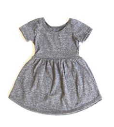 Updated for Fall in our most flattering fit yet! A staple dress for any little lady's wardrobe! Features a scoop neck, fitted sleeves and elastic empire waist. Pair it with tights and a jean jacket in