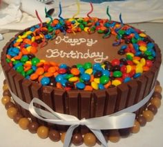 Super fun and easy cake to make! Chocolate cake on inside and then you icing it and place kit kats all around and m on top and whoppers or any type of candy you want as the bottom border! anyone can do this!