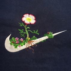 As part of his new series of embroidery artist, James Merry decided to soften the sharp lines of sports logos, as sewn floral patterns to old clothes. Mary works many years with Bjork, creating the costumes for her stage performances and music videos. Custom Embroidery, Floral Embroidery, Embroidery Stitches, Embroidery Patterns, Hand Embroidery, Simple Embroidery, Embroidery Fashion, Broderie Anglaise Fabric, Logo Fleur