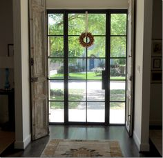 Front door, industrial window look. {Hartley and Hill Design Blog} LOVE the openness of the door, with the optional privacy of the indoor shutters.