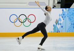 Mao Asada of Japan skates during a practice session at the figure stating practice rink at the 2014 Winter Olympics, Monday, Feb. 17, 2014, ...