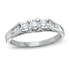 What do you think of this one Amanda? When you look at the side of the ring it has hearts!!!  0.50 ct. t.w. diamond three stone ring set in 10K white gold features a 0.18 ct. princess-cut diamond centre stone with princess-cut and round side diamonds. $879 (Reg $1,149) until November 6. Online only. People's