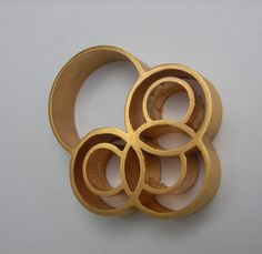 The Insignia Ring  18K Gold Plated Copper Piping by aranajewelry.......Connie Fox: Repetition of circles.