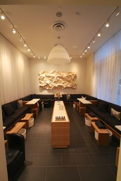 Manicure/pedicure area with wooden tessellation artwork on the wall.