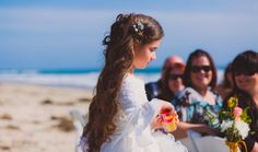 Flower girl walking down the aisle at a Wrightsville Beach, NC wedding.