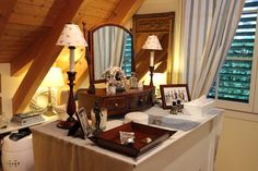 ...collected bits and pieces from antiques centers and bric-a-brac shops adorne the dressing table in the dressing room.