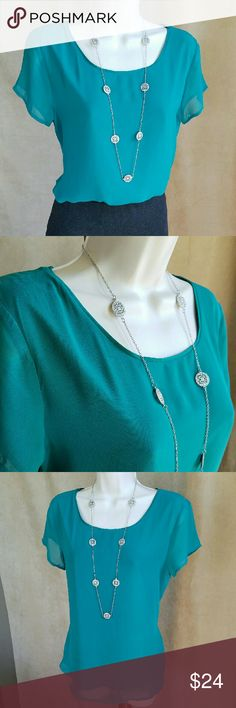 Ann Taylor teal green blouse Teal green short-sleeved blouse with sheer layer over matching lining.  Simple and classy.  Shell & lining 100% polyester.  Thanks for visiting my closet; come back soon & see what's new! I add listings every week! Ann Taylor Tops