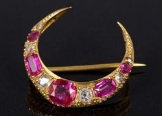 Victorian ruby and diamond crescent brooch with five mixed cut rubies, interspaced by five old cut and rose cut diamonds in gold setting with pierced gallery, 22mm x 22mm