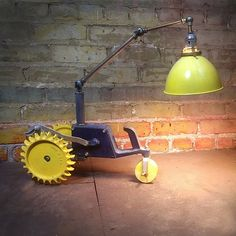 Lawn Tractor bedside reading lamp by Omega Lighting Design | Please subscribe to my weekly newsletter at upcycledzine.com ! #upcycle