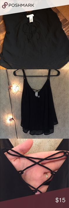 Lace up front crop top! Adorable lace up top crop top! Goes to waist length but easily can be worn tucked or untucked with basically literally any bottoms! Adds a very sweet vibe to any outfit! Worn once! In perfect condition! Tops Crop Tops