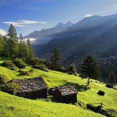 first sun rays in the valley, Zermatt, Switzerland