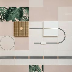 Lines of conductive ink thread between the protruding speakers and light boxes that form this interactive wall display, designed by UM Project and Flavor Paper.